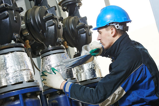 industrial construction worker at boiler