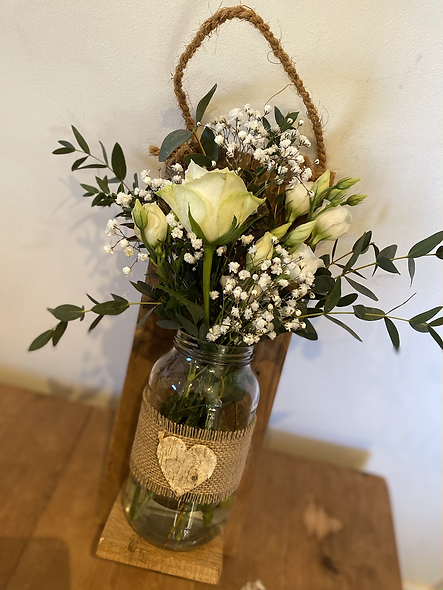Recycled wooden plaque with vase