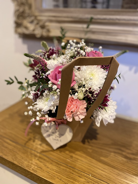 Bag of flowers with plaque
