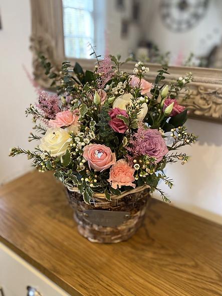 Pastel basket of roses