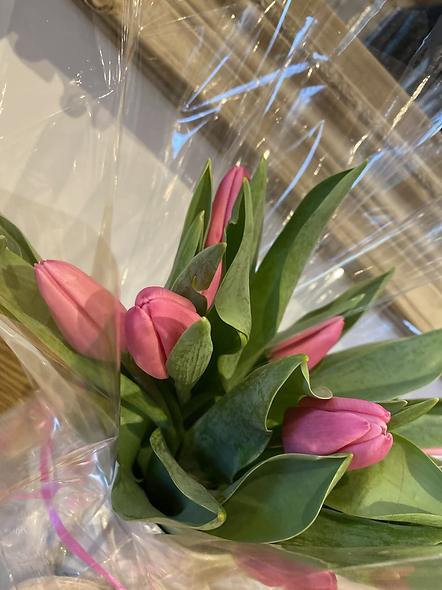 Tulips in a small milk chun