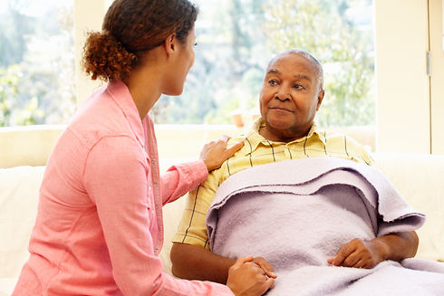 Woman looking after sick father.jpg
