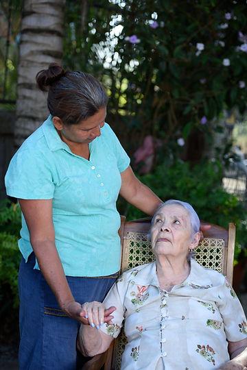 nurse help to old grandma in green park.