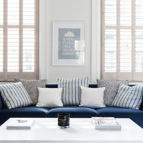 Sofa in front of shutters.png