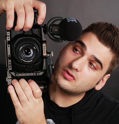 Riccardo Ciccone Roundhouse Media Founder Holding Video Camera with Rode Microphone