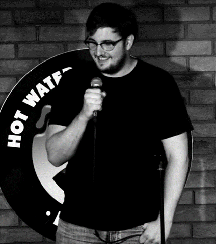 Standup comic Ben Sherlock performing li