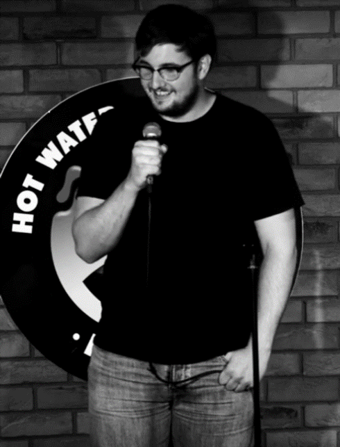 Standup comic Ben Sherlock performing li