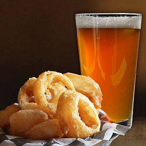 Pint of beer and onion rings