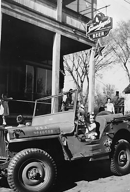 Ernie Starr's Daughter In A War Era Jeep Parked In Front Of Starr's Bar. Fall 1945.