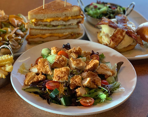 Our Crispy Chicken Salad in front with some of our lunch options in the background