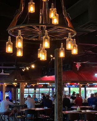 Wagon wheel chandelier in our Wild Bill's Fargo location