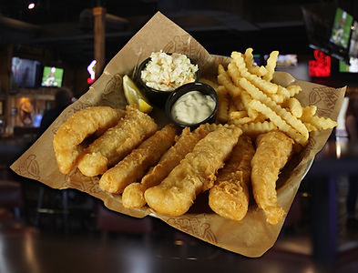 A plate of our Hand-Battered Cod that is served with crinkle cut fries, coleslaw, tartar sauce & a lemon wedge.