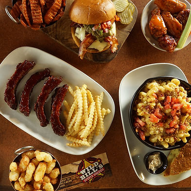A collage of ribs, burgers, cheese curds, wings and mac n' cheese