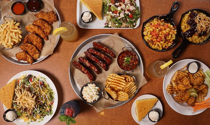 An Array of food we offer: Chicken Tenders, Salads, Ribs, Mac N Cheese And Wings.