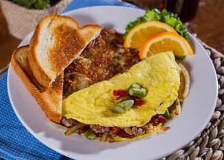 Three Meat Omelette: Three Egg Omelette Stuffed With Ham, Bacon, Sausage And Monterey & Cheddar Jack Cheese. Served With Hash Browns And Toasted Multi-Grain Or White Vienna Bread.