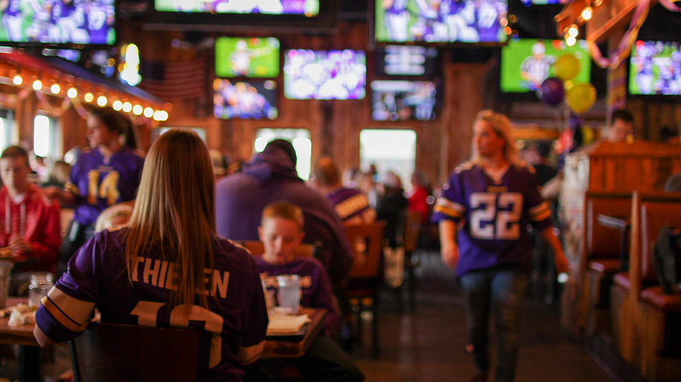 Girl sitting with her back towards you in a Vikings jersey
