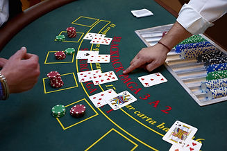 Blackjack table with chips and cards being played
