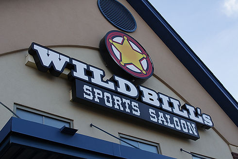 Wild Bill's Sports Saloon Logo outside on one of our Wild Bill's restaurants