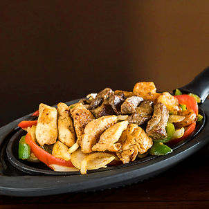 Our Fajita showing the three meat options available: chicken, steak or shrimp