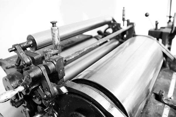 Traditional printer gears and rollers.