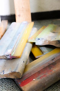 Squeegees used for silkscreen apparel products.
