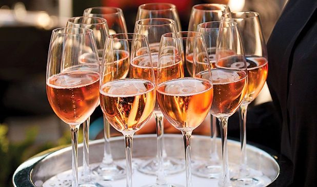 glasses-of-rose-champagne-served-at-rece