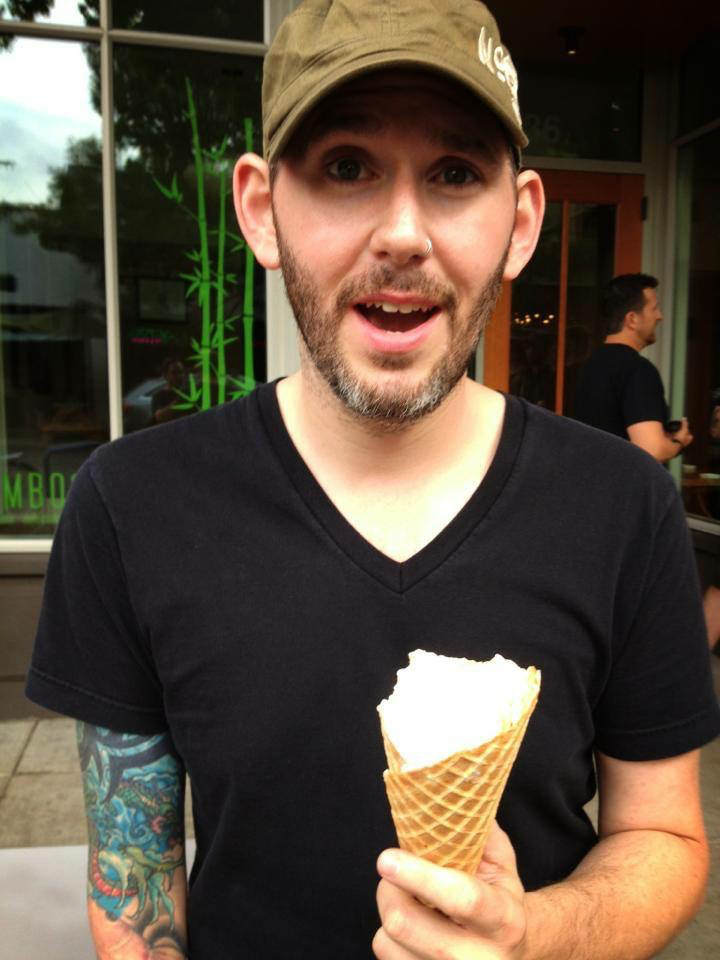 "Jason smiling a ""I cant believe it"" smile, while holding an ice cream cone"