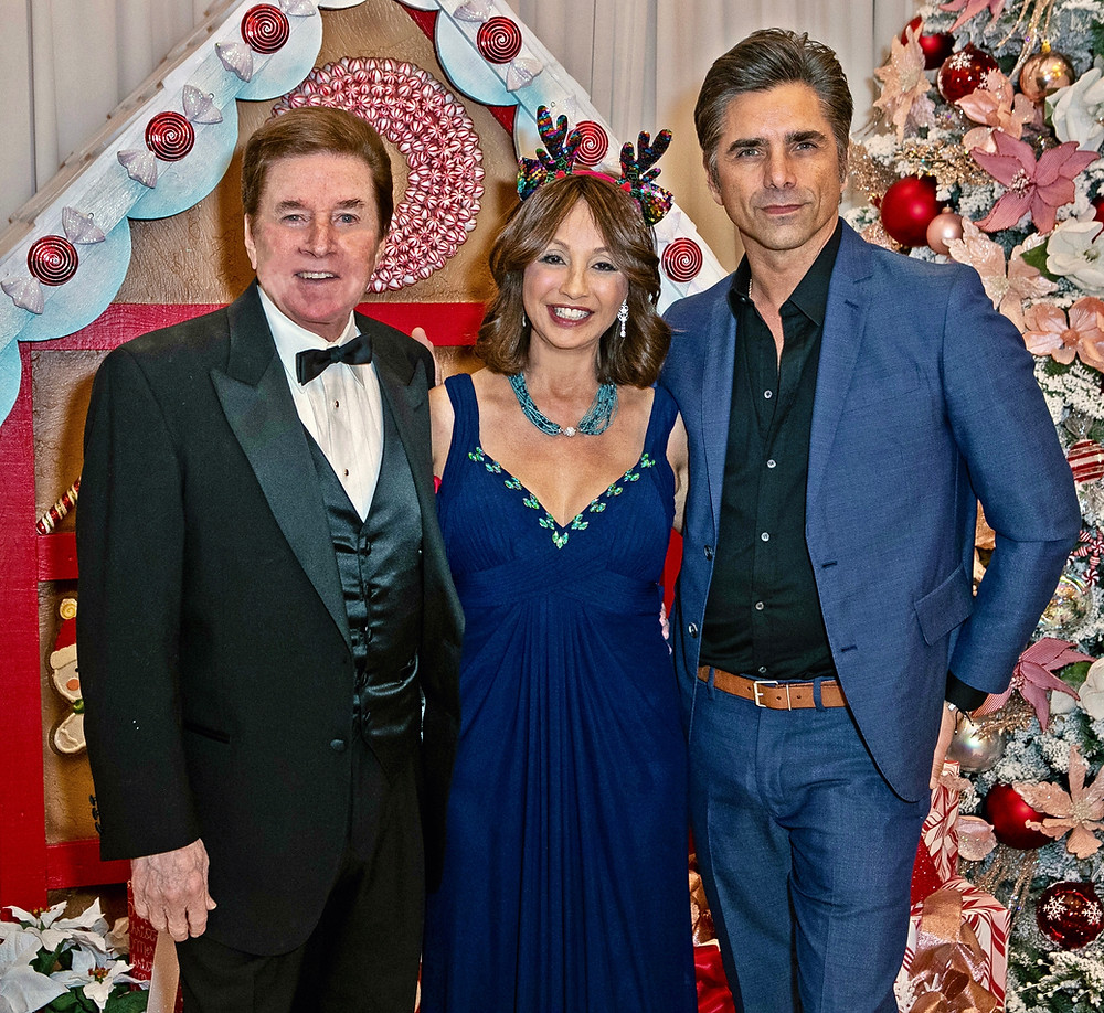 John Stamos taking a photo with BBSCF Founders Brigitte and Bobby Sherman