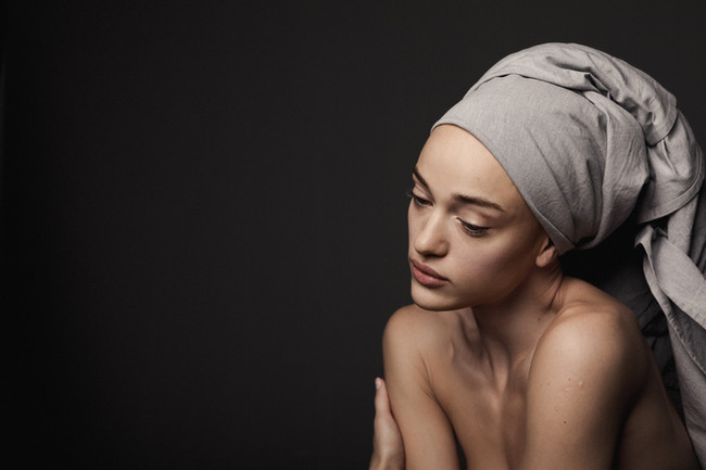 Young woman with a grey headscarf