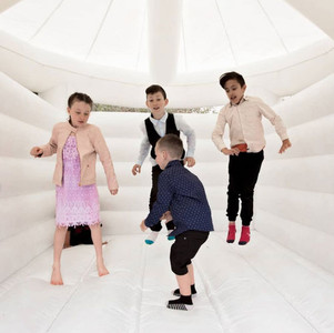 Kids jumping on white inflatable