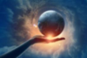 Globe,Clouds,FemaleHand.jpg