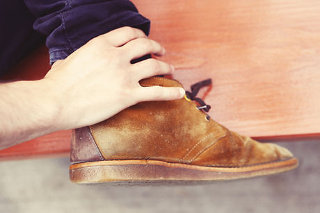foot-brown-shoe