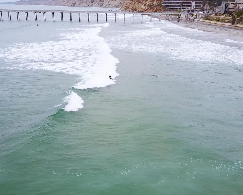 Surfing near Scripps Pier in La Jolla