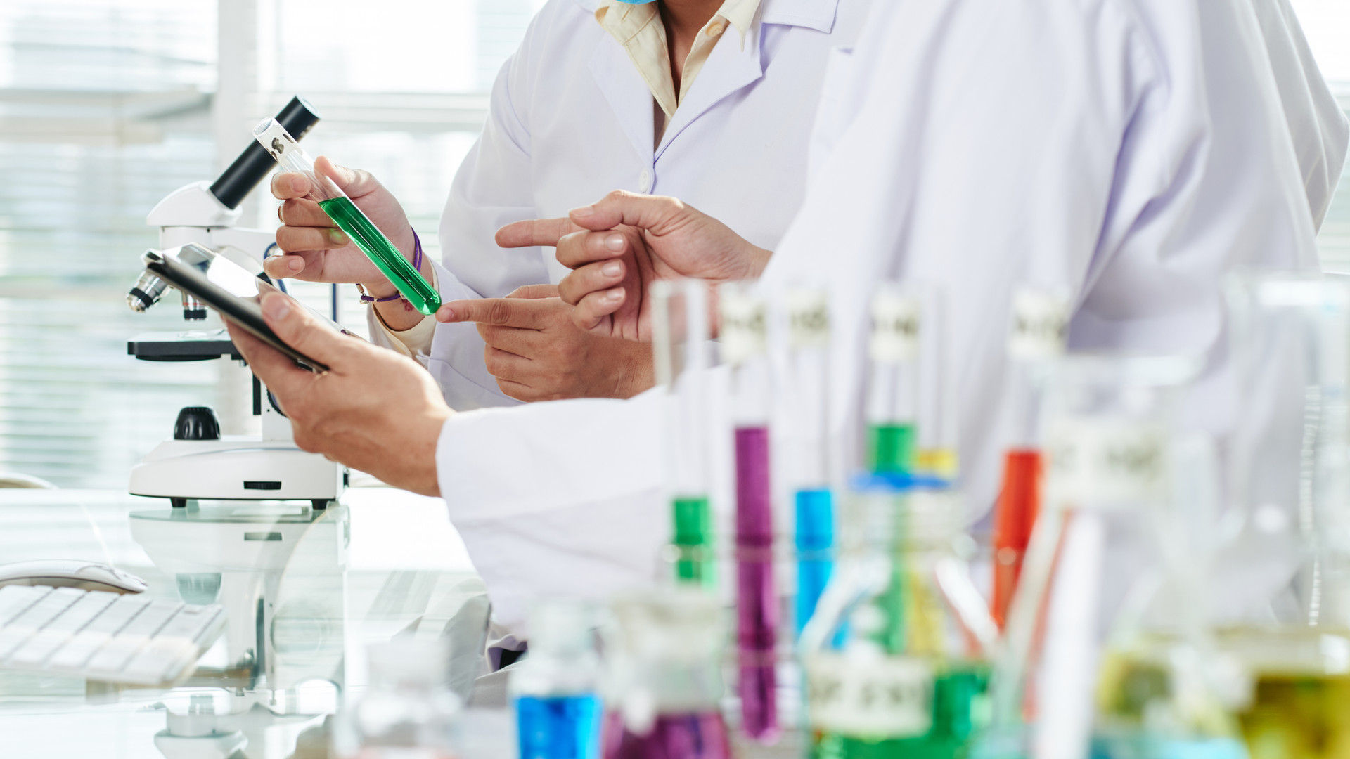chemists-carrying-out-experiment.jpg