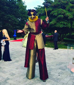 Gold & Burgundy Stilt Walker