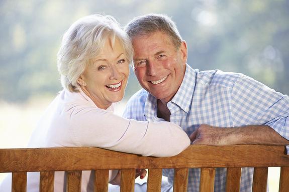 Senior couple sitting outdoors.jpg