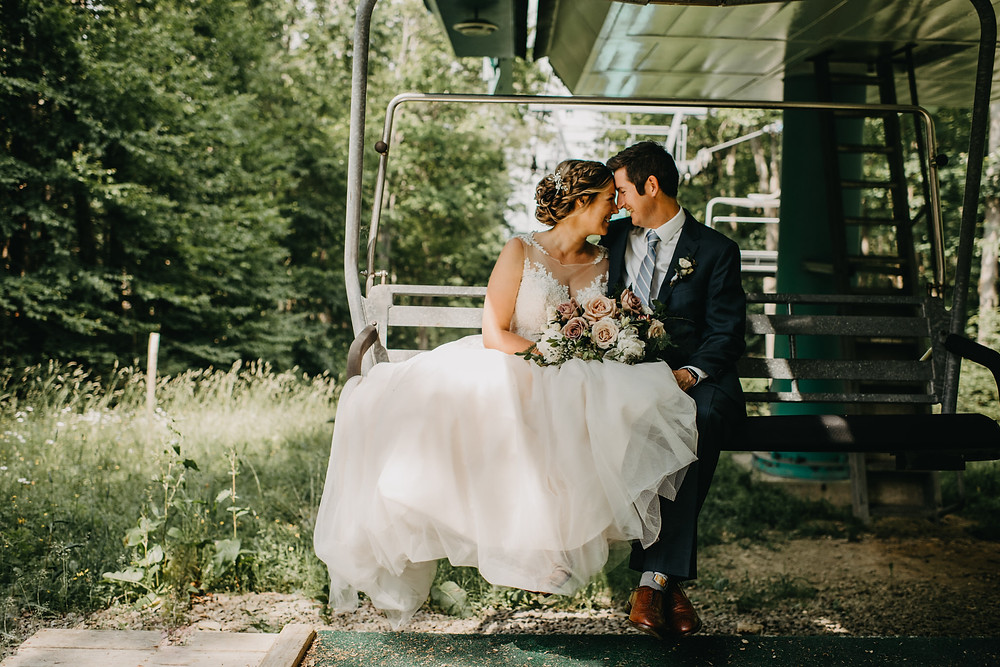 Bride and Groom at Ellicottville Ski Resort on Wedding Day in Summer. Smiling on Chairlift