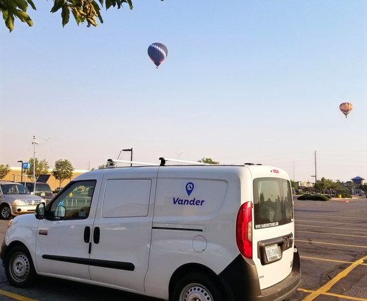 Vander Cascade compact campervan with two hot air balloons in the sky