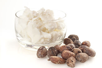 shea nuts near butter, isolated on white