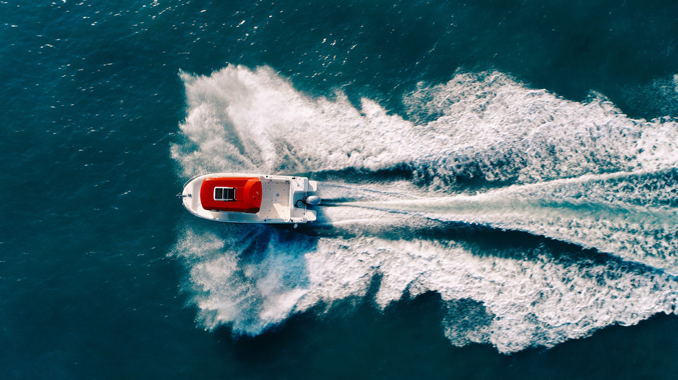 Top down boat sea sea hitting waves aerial drone filming