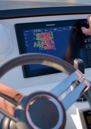 Motoryacht navigation filming helm at sea
