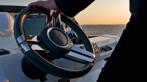 Helm on the flybridge of a luxury yacht