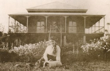 Mary Roche in front of homestead