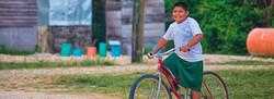 Blue Creek kid riding his bicycle