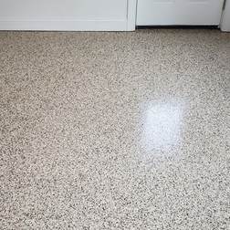 The end result of all that prep and proper installation or our industrial strength epoxy coating system is a beautiful new floor that you'll be proud to show off and will enjoy for many, many years.  •Aesthetically pleasing •Non-Porous surface •Easy clean up (liquids simply bead on top for quick wipe up) •UV resistant and non-yellowing clearcoats to provide long lasting good looks.   Another space transformed from ordinary to Extraordinary by Carolina Epoxy Garage
