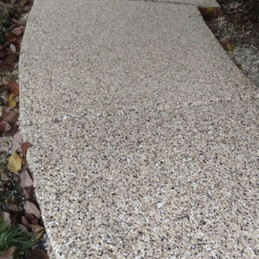 Sidewalk in Cary NC finished in Cappuccino flake color