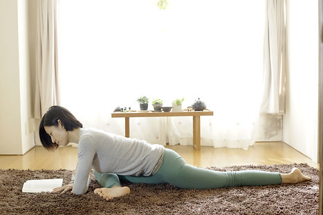 8 yin yoga poses you can practice while reading a book