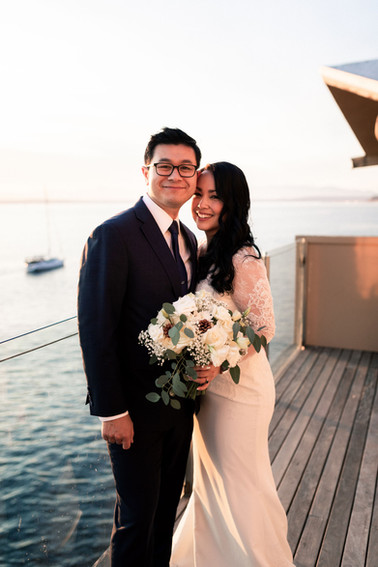 Oceanside portrait of the newlyweds