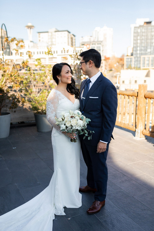 Couple portrait with Seattle Space Needle in the background