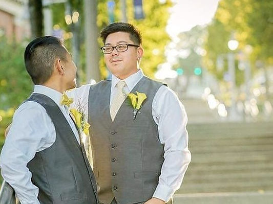 Gay couple smiling at each other at the Washington State Hstory Museum in Tacoma Washington